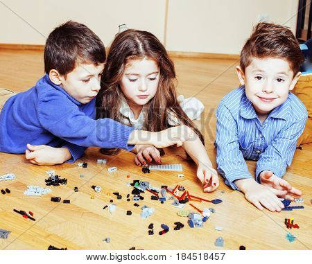 funny cute children playing toys at home, boys happy smiling, first education role lifestyle close up