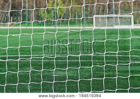 Football Net Background Over Soccer Field Stadium
