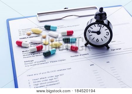 Health checkup time with medicine on medical form