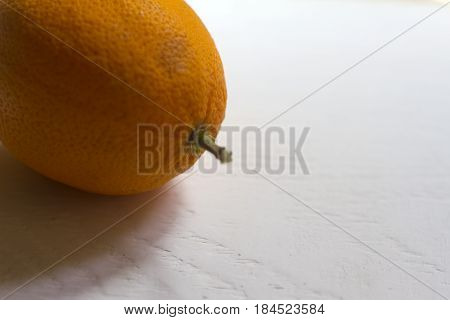 Detail of an orange on a neutral background