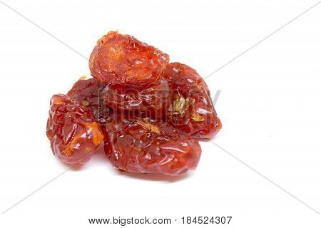 sun-dried sweet tomatoes isolate on white background. selective focus