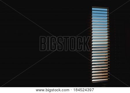 Wood blinds or curtain and sun light in behind