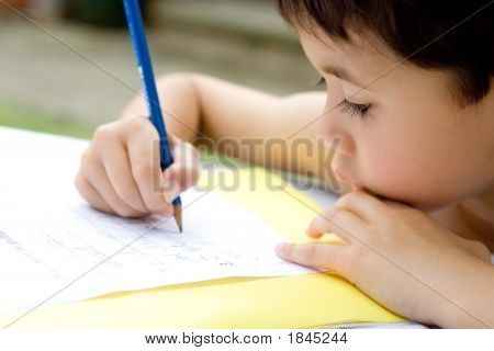Boy Enjoying His Handwriting Homework