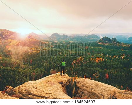 Photographer Working With Mirror Camera And Tripod On Peak Of Rock. Dreamy Fogy Landscape