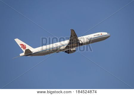 Frankfurt Germany - March 30 2017: Air China Boeing 777-300 ER after take off at the Frankfurt international airport