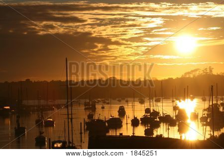 Boats On The Waterat Sunrise