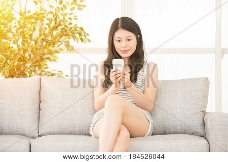 She Is Using A Smartphone And Texting