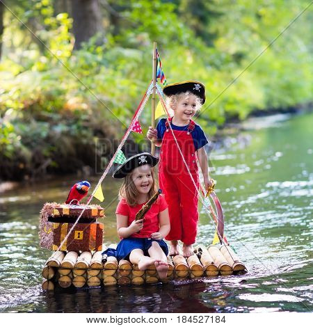 Kids Playing Pirate Adventure On Wooden Raft