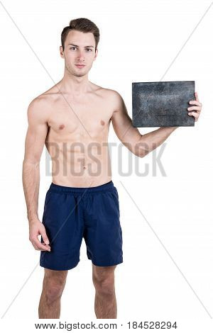 Healthy Lifestyle. Portrait Of A Handsome Guy With A Naked Body, With A Blank Signboard For Writing,