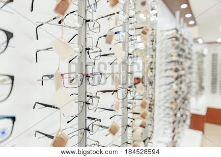 Shop-front with various optic eyewears. Copy space on right side