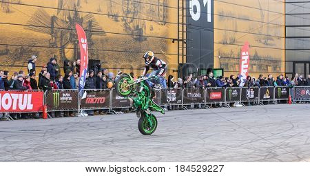 St. Petersburg Russia - 15 April, In flight over a motorcycle,15 April, 2017. International Motor Show IMIS-2017 in Expoforurum. Sports motorcycle show of bikers on the open area.