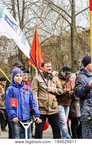 Kirishi, Russia - 1 May, Adults and teens at the May demonstration,1 May, 2017. People at the May demonstration and rally in the Russian provincial government.