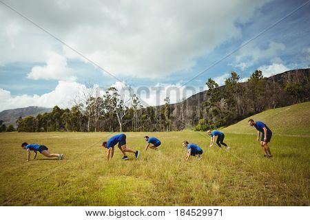 Fit people performing pushup exercise in bootcamp