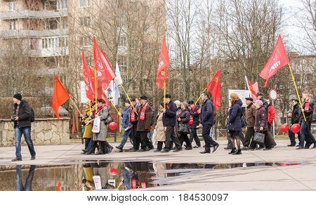 Kirishi, Russia - 1 May, Group of people with flags,1 May, 2017. People at the May demonstration and rally in the Russian provincial government.