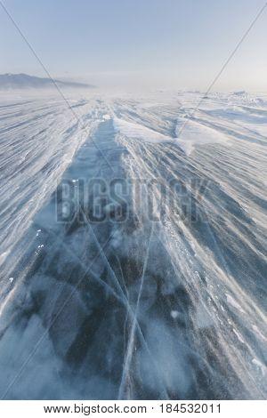 Snowstorm. Ice Of Lake Baikal. Winter Landscape