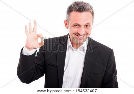 Portait Of Cool Young Male Doing Ok Symbol