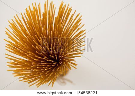 Bundle of raw spaghetti on white background
