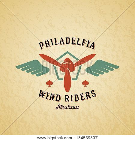 Wind Riders Airplane Vector Retro Label, Sign or Logo Template. Vintage Plane Airscrew in a Shield with Wings, Typography and Shabby Texture. On a Background.
