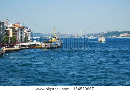 The View Of  Bosphorus And Bosphorus Bridge With The Ship Moored At The Kadikoy Quay. Istanbul
