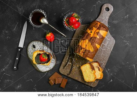 Breakfast strawberry bruschetta with chocolate sauce. Healthy fruit sandwich with strawberry. Ingredients for sandwiches biscuit bread fresh strawberries chocolate. Dark black background. Top view
