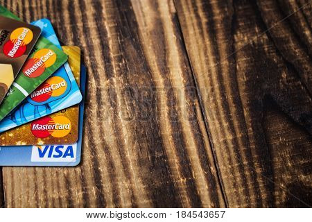 debit and credit cards maestro and visa on wooden background