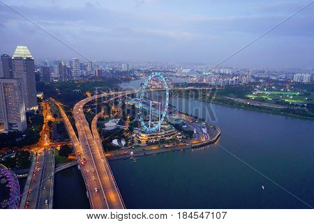 Singapore, Singapore - February 12, 2017: Singapore Flyer and Singapore river in Singapore