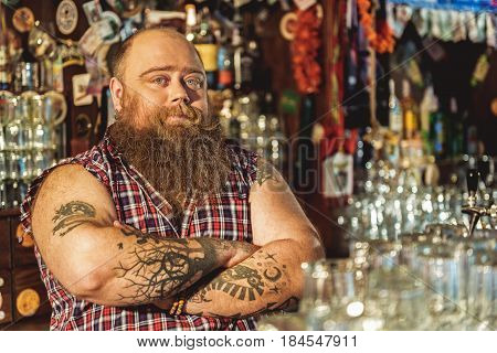 I love my job. Portrait of fearless fat man working in boozer
