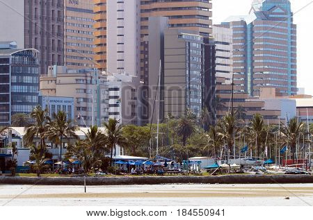 DURBAN SOUTH AFRICA - APRIL 9 2017: Early morning close-up view of Yacht Club against city Skyline in Durban South Africa