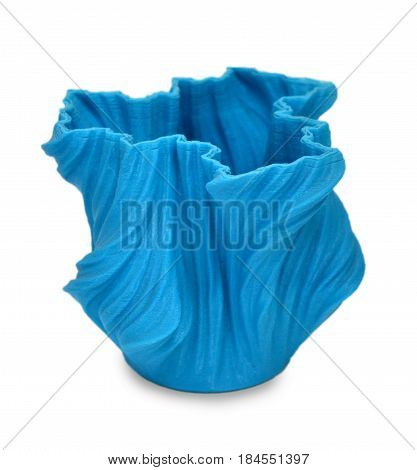 Objects printed by 3d printer Isolated on white background. Bright colorful object. Vase of blue color. Automatic three dimensional performs plastic modeling. Modern 3D printing technology.