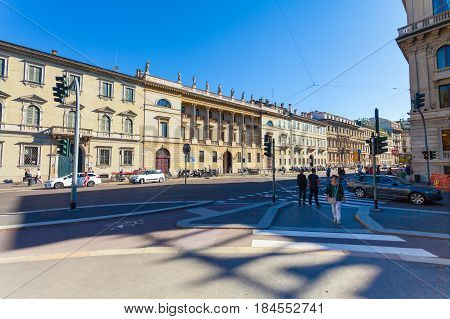 MILAN ITALY - September 06 2016: Pedestrians are waiting the green light of traffic light on the crossroad on Avenue Buenos Aires (Corso Buenos Aires) and street Palestro where there is a bicycle lane for bicyclists