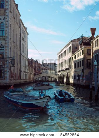 Grand canal in venice with rialto bridge and boats