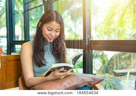 Enjoy Relax Times With Reading Book, Asian Women Thai Teen Smile With Book In Coffee Shop Vintage Co