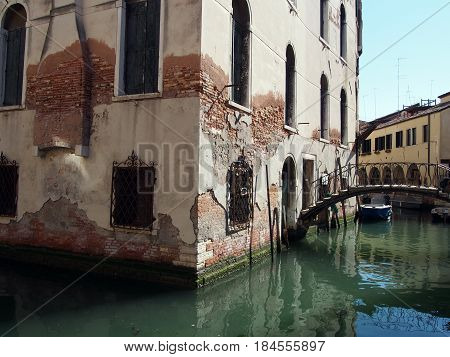 old building on a canal in Venice with small bridge