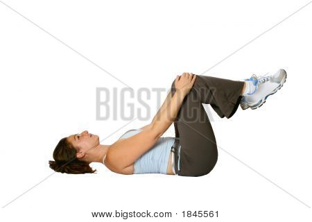 poster of Female fitness trainer doing stretching for the muscle at the back of her thigh as part of winding down exercise isolated on white.