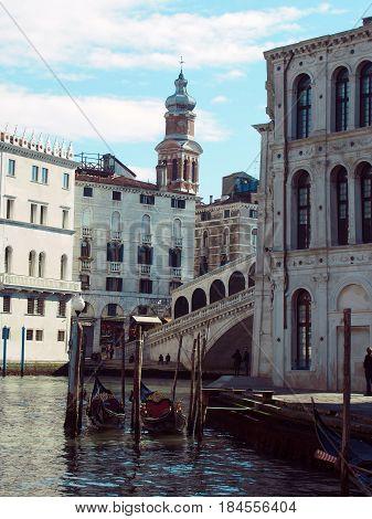 Canal in venice showing the rialto bridge