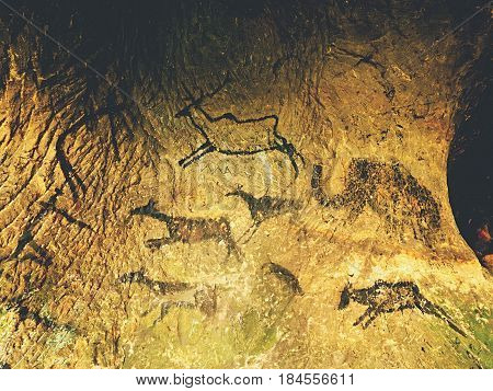 Paint Of Human Hunting Of Deers, Mammoth And Reindeer. Historical Black Carbon Abstract Art