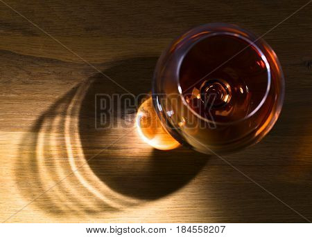 Snifter Of Brandy On A Wooden Table