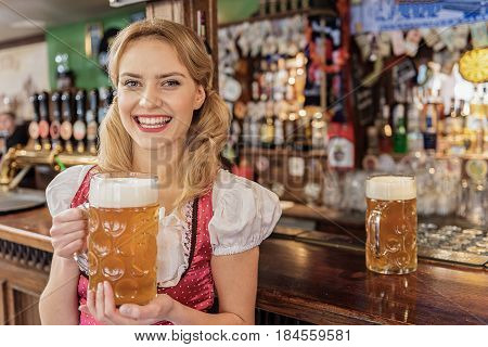 Here is your order. Waitress expressing blessedness while giving glass of cold foamy beer in pub