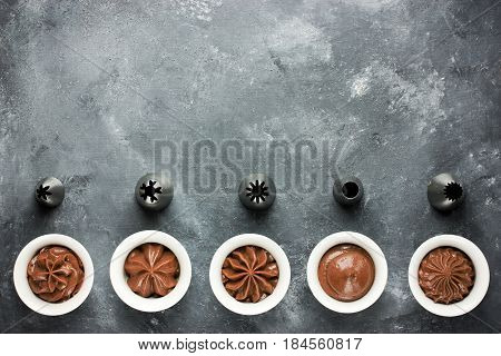 Set of chocolate cream swirl and metal nozzles for confectionery bag top view