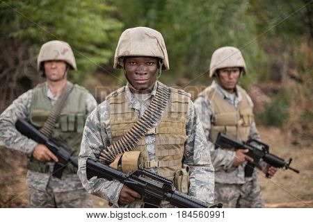 Military soldiers during training exercise with weapon at boot camp