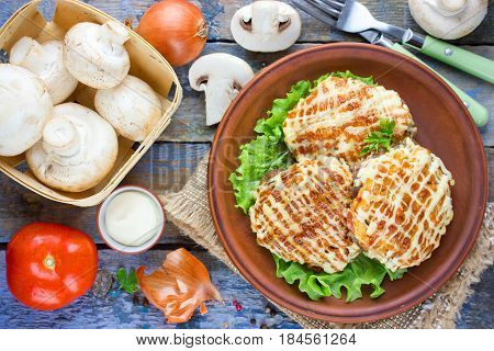 Veal Prince Orloff or French meat - veal chops with mushrooms tomatoes onion cheese and mayonnaise top view