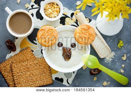 Food art idea for funny and healthy breakfast - creamy oat bran porridge shaped koala