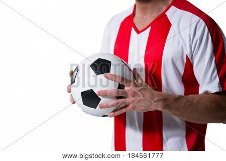 Mid-section of football player holding football with both hands against white background