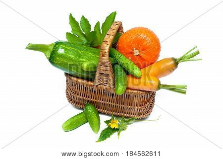 Vegetables in a wicker basket isolated on white background. Horizontal photo.