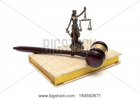 statue of justice gavel and book on a white background. Horizontal photo.
