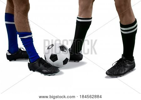 Two football players playing football against white background