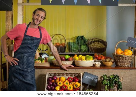 Portrait of male staff standing in organic section of supermarket