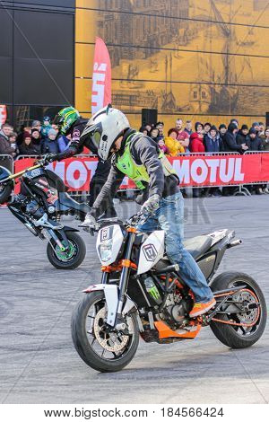 St. Petersburg Russia - 15 April, Moto freestyle group,15 April, 2017. International Motor Show IMIS-2017 in Expoforurum. Sports motorcycle show of bikers on the open area.