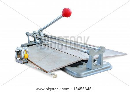 Tile cutter tool cutting a ceramic tile isolated on white.