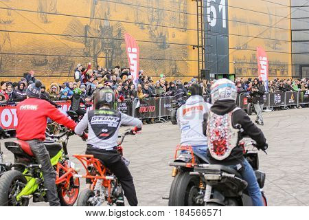 St. Petersburg Russia - 15 April, Participants and spectators of the motor show,15 April, 2017. International Motor Show IMIS-2017 in Expoforurum. Sports motorcycle show of bikers on the open area.